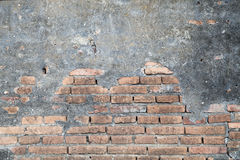 Old brick wall in a background image   with vignetted  grunge ba Royalty Free Stock Photos