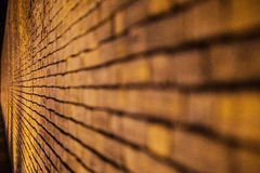 Old brick wall background night time Stock Images