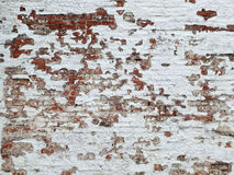 Old brick wall background with white paint. Old distressed brick wall background with white peeling paint Stock Photo
