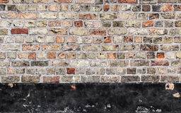 Old brick wall with black stripe, background Royalty Free Stock Image