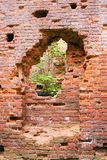 Old brick wall with a breach. Manor's Ruins  in village Gostilitsy, St. Petersburg region, Russia Stock Photo