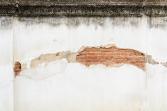 Old brick wall broken. Old brick wall outer layer broken and show grunge red brick Royalty Free Stock Photography
