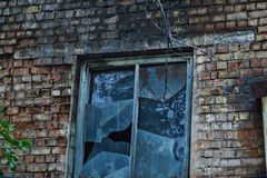 Old brick wall with broken window Stock Photos