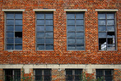 Old brick wall with broken windows Royalty Free Stock Photos