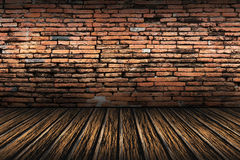 Old brick wall and brown wooden floor Stock Photo
