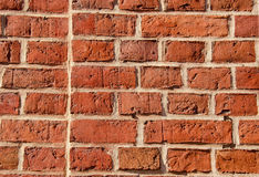 Old brick wall built of clay bricks. Royalty Free Stock Photography