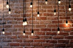 Old brick wall with bulb lights lamp. Old red brick wall with bulb lights lamp Stock Images
