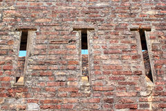 Old brick wall with channels Royalty Free Stock Photo