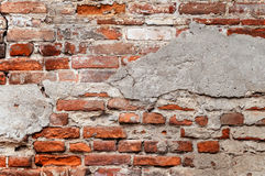 Old brick wall with chipped plaster Stock Photo