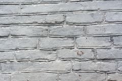 Old brick wall close-up painted white stock photography
