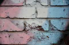 Old brick wall with colorful graffiti Royalty Free Stock Photo