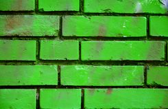 Old brick wall with colorful graffiti Stock Images