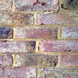 Old Brick Wall. A colourful old brick wall background Royalty Free Stock Photography
