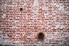 Old brick wall with a crack. Old red brick wall with a crack and traces of paintrr Stock Photos