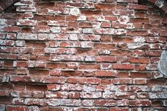 Old brick wall with a crack. Old red brick wall with a crack and traces of paintrr Royalty Free Stock Images