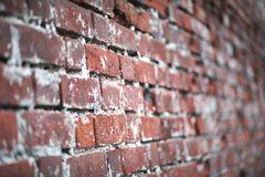 Old brick wall with a crack. Old red brick wall with a crack and traces of paintrr Stock Photography