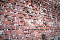 Old brick wall with a crack. Old red brick wall with a crack and traces of paintrr Royalty Free Stock Photo