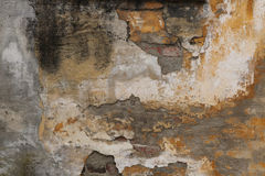 Old brick wall with cracked plaster. Background. Stock Photo