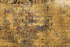 Old brick wall with cracked plaster. Background. Stock Images