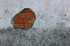 Old Brick Wall with crumbling Plaster. And paintings Stock Photography