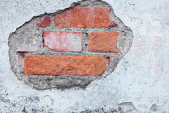 Old Brick Wall with crumbling Plaster. And paintings Royalty Free Stock Photography
