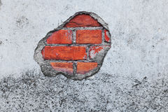 Old Brick Wall with crumbling Plaster. And paintings Stock Images