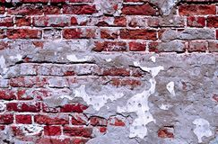 Old brick wall with crumbling plaster Stock Photo