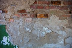 Old brick wall with the damaged plaster Royalty Free Stock Photos
