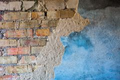 Old brick wall with the damaged plaster Royalty Free Stock Image