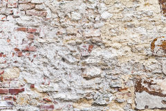 Old brick wall with damaged yellow stucco Royalty Free Stock Photography