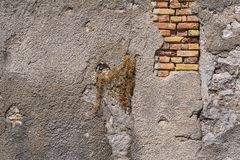 Old brick wall with the destroyed plaster Royalty Free Stock Photography