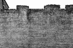 Old brick wall of fortress gray color Stock Images