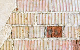 Old brick wall fragment with red brick accent Stock Photography