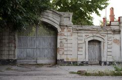 Old brick wall with a gate and a door royalty free stock photo