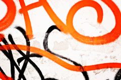 Old brick wall with graffiti. Old brick wall with black and orange graffiti Stock Photography