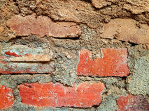 OLD BRICK WALL GRAINED TEXTURE. AN OLD BRICK WALL GRAINED TO USE AS A TEXTURE OR AS A WALPAPER Royalty Free Stock Photo