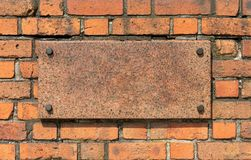 Old brick wall with granite board Stock Photos