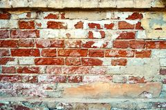 Old brick wall. Grunge background of Weathered brickwall with white plaster on texture close up royalty free stock image