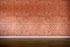 Old brick wall with hardwood floor, vintage, retro. Weathered, backdrop, high contrast, background royalty free stock photography