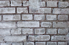 Old brick wall of the house. Mediocrity Stock Photos