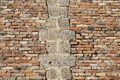Old brick wall inlaid regularly Stock Photo