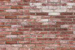 Old brick wall inlaid regularly Stock Photos