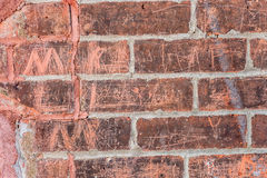 Old brick wall. With inscriptions Stock Photo
