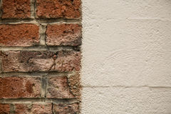 Old brick wall juxtaposed white wall. Concept juxtaposition old new brcks stock image