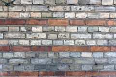 Old brick wall with lines of bricks. Stock Photos
