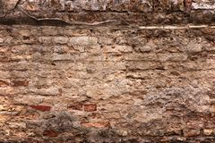 Old brick wall with loose bricks and deteriorating Royalty Free Stock Images