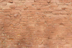 Old brick wall, old texture of red stone blocks. Closeup Stock Photo