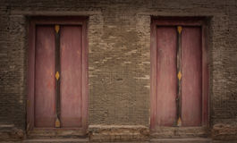 Old brick wall and old wooden door,Temple Thailand Royalty Free Stock Image
