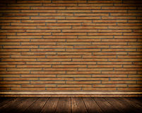 Old brick wall and old wooden floor background. Stock Image