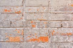 The old brick wall is painted in a dirty beige beauty. Peeling paint. Blank background with brickwork texture. Light photo royalty free stock image